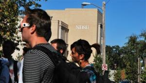 Students gather outside North Dakota State University's Klai Hall after the downtown campus, along with the main campus, was evacuated because of a bomb threat Friday.