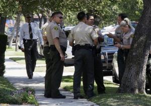 Los Angeles County sheriff's deputies stand down the street from a suburban Los Angeles home believed to be that of Nakoula Basseley Nakoula Friday.