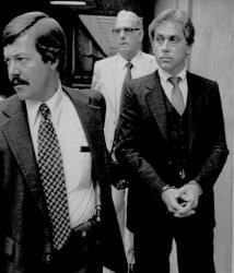In this Aug. 28, 1979, file photo, Jeffrey MacDonald, right, appears in federal court in Wilmington, N.C.