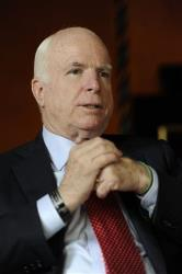 Sen. John McCain speaks on the sidelines of a meeting on World Economy in Cernobbio, Italy, Saturday, Sept. 8, 2012.