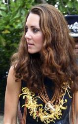 Britain's Kate, the Duchess of Cambridge, wears a garland of orchids as she arrives in Tavanipupu, Solomon Islands, with Prince William, Monday, Sept. 17, 2012.
