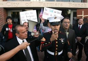 In this Nov. 13, 2006 file photo, former Marine Sgt. Salvador Parada speaks to protesters during a rally outside city hall in Farmers Branch, Texas.