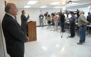Alamance County Sheriff Terry S. Johnson stands to the side as his attorney, Chuck Kitchens, speaks to reporters Tuesday, Sept. 18, 2012, in Graham, N.C.