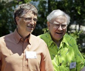 Bill Gates and Warren Buffett, seen in this file photo, are the top two names on the Forbes 400.