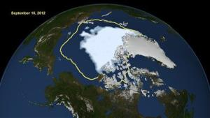 This NASA image shows the amount of summer sea ice in the Arctic on Sunday, Sept. 16, 2012, at center in white, and the 1979 to 2000 average extent for the day shown, with the yellow line.