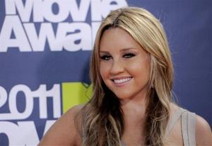 Amanda Bynes  arrives at the MTV Movie Awards on Sunday, June 5, 2011, in Los Angeles.