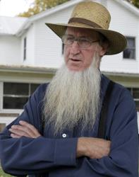 Sam Mullet Sr. stands in the front yard of his home in Bergholz, Ohio, in this file photo from last year.