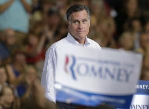 Mitt Romney pauses as supporters cheer to remarks during a rally Friday, Sept. 21, 2012, in Las Vegas.