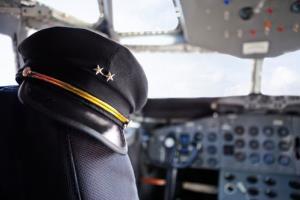 A captain's hat on a plane.