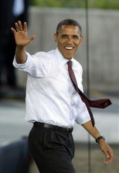 President Barack Obama waves as he is introduced during a campaign stop Saturday, Sept. 22, 2012, in Milwaukee.