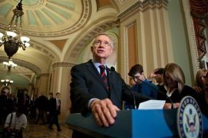 In this Sept. 19, 2012, file photo Senate Majority Leader Harry Reid speaks with reporters following a Democratic strategy luncheon on Capitol Hill in Washington.