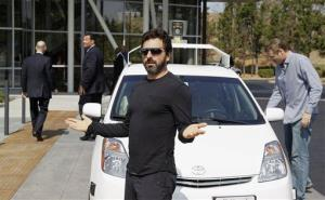 Sergey Brin gestures after riding in a driverless car with Gov. Jerry Brown and state Sen. Alex Padilla to a bill signing for driverless cars at Google HQ, Tuesday, Sept. 25, 2012.