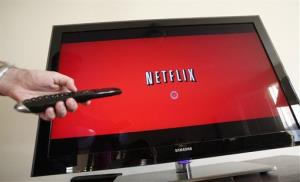 A Netflix subscriber gets ready to watch a streamed move on the TV.