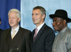 Bill Clinton, Norway PM Jens Stoltenberg, center, and Goodluck Jonathan, president of Nigeria, right, at a UN news conference.