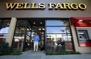 In this Jan. 18, 2011 file photo, a customer exits a Wells Fargo bank branch in Los Angeles.
