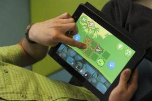 A demonstrator plays the new Bad Piggies game from Finnish company Rovio Entertainment, the creators of Angry Birds.