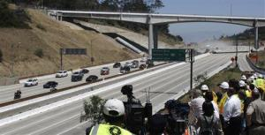 This July 17, 2011 file photo shows the California Highway Patrol leading the first vehicles on Interstate 405 as demolition of a portion of the bridge is completed before noon in Los Angeles.