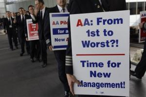 Over 200 American Airline pilots march on a picket line at O'Hare International Airport Thursday, Sept. 20, 2012 in Chicago, Ill.