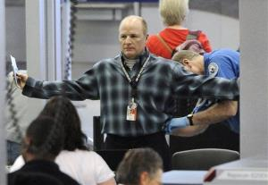 An traveller is patted down by a TSA agent at O'Hare International Airport in Chicago.