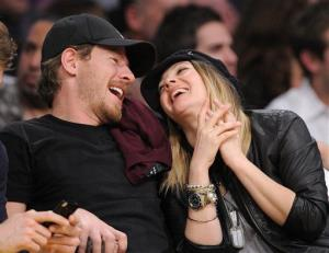 Actress Drew Barrymore sits with Will Kopelman as they watch the Los Angeles Lakers play the Los Angeles Clippers in their NBA basketball game, Friday, March 25, 2011, in Los Angeles.