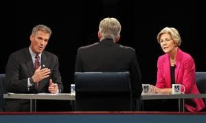 Scott Brown gestures as he answers a question during a debate against Democratic challenger Elizabeth Warren, at the University of Massachusetts in Lowell, Mass., Monday, Oct. 1, 2012.