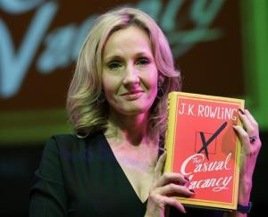 JK Rowling poses for the photographers with her new book, 'The Casual Vacancy,' at the Southbank Centre in London, Thursday, Sept. 27, 2012.