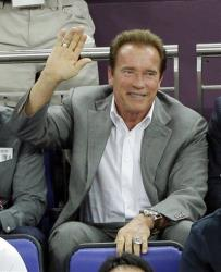 Arnold Schwarzenegger watches the men's gold medal basketball game between the United States and Spain at the 2012 Summer Olympics in London.