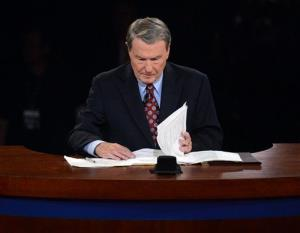 Moderator Jim Lehrer looks over his notes before the presidential debate at the University of Denver.