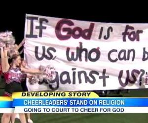 Cheerleaders at Kountze High School hold up one of their controversial banners.