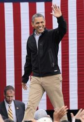 President Obama waves as he arrives at a campaign rally in Denver Thursday.