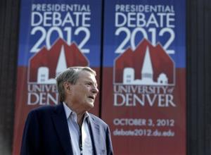 Jim Lehrer stands outside the Magness Arena on the campus of the University of Denver on Monday.