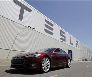 A Tesla Model S drives outside the Tesla factory in Fremont, Calif., Friday, June 22, 2012.