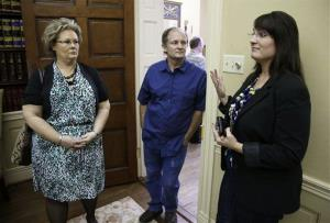 From left, Teresa Russell, Jeffrey Russell, and Tracy Barreiro, children of Janet Russell, in Nashville, Tenn. on Thursday, Oct. 5, 2012. Janet Russell has been infected with meningitis.
