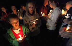 Family members of Border Patrol Agent Nicholas Ivie participate in Thursday Oct. 4, 2012, candlelight ceremony in Naco, Arizona.
