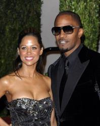 Stacey Dash, left, and Jamie Foxx arrive at the Vanity Fair Oscar party on Sunday, March 7, 2010, in West Hollywood, Calif.