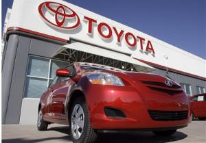 FILE - in this Oct. 22, 2006 file photo, the Toyota sign hangs over a 2007 Yaris sedan on sale on the lot of a Toyota dealership in the southeast Denver suburb of Centennial, Colo. Toyota Motor Corp. is recalling 7.43 million vehicles in the U.S., Japan, Europe...