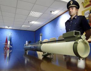 In this photo taken on Oct. 5, 2010 an Italian Police officer stands by a bazooka that was found near a courthouse in Reggio Calabria, Southern Italy.