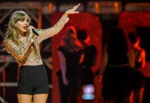 In this Sept. 22, 2012 file photo, Taylor Swift performs at iHeart Radio Music Festival at the MGM Grand Arena in Las Vegas.