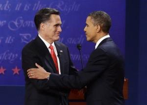 President Obama and Mitt Romney talk at the end of the first presidential debate in Denver.