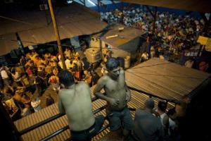 Inmates gather outside their cells in San Pedro Sula Central Corrections Facility in San Pedro Sula, Honduras.