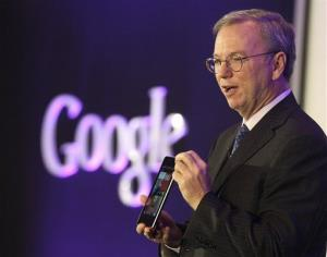 Eric Shcmidt, executive chairman of Google Inc., shows the Nexus 7 tablet during a press conference in Seoul, South Korea, Thursday, Sept. 27, 2012.