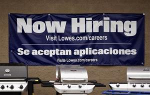 A Lowes store advertises job openings near its gas grills outside the home improvement store in Pembroke, Mass., May 8, 2012.