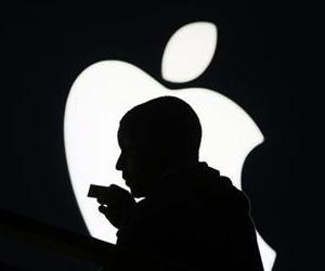 A customer is silhouetted against the Lenox Mall Apple store icon in Atlanta in this file photo.