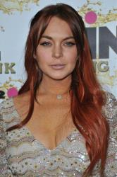Lindsay Lohan attends the Mr. Pink Ginseng launch party at the Beverly Wilshire hotel on Thursday, Oct. 11, 2012, in Beverly Hills, Calif.