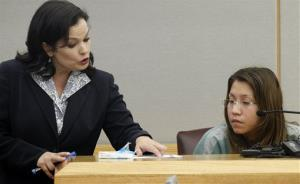 In a Thursday, Oct. 11, 2012 file photo, prosecutor Eren Price, left, points to a piece of states evidence as she addresses Elizabeth Escalona, 23, during Escalona's sentencing proceedings  in Dallas.