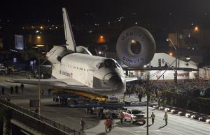 The Space Shuttle Endeavour is slowly moved across Interstate 405 by a Toyota Tundra, Friday, Oct.12, 2012, in Los Angeles.