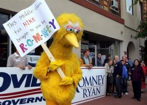 A person dressed up as Big Bird holds a sign against Republican presidential candidate, former Massachusetts Gov. Mitt Romney outside the Romney headquarters, Monday, Oct. 8, 2012 in Derry, NH.