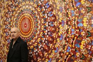 British artist Damien Hirst stands beside his 2006 piece I Am Become Death, Shatterer of Worlds, which used the wings of thousands of butterflies.
