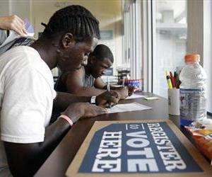 People register to vote at a campaign office for President Barack Obama in this file photo.