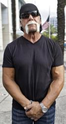 Hulk Hogan, whose real name is Terry Bollea, waits to cross the street as he leaves the United States Courthouse after a news conference Monday, Oct. 15, 2012 in Tampa, Fla.